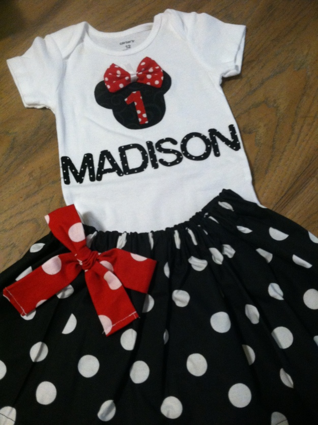 My daughter's first birthday outfit!  Someone loves Mickey.